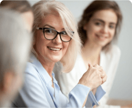 Woman smiling at a meeting